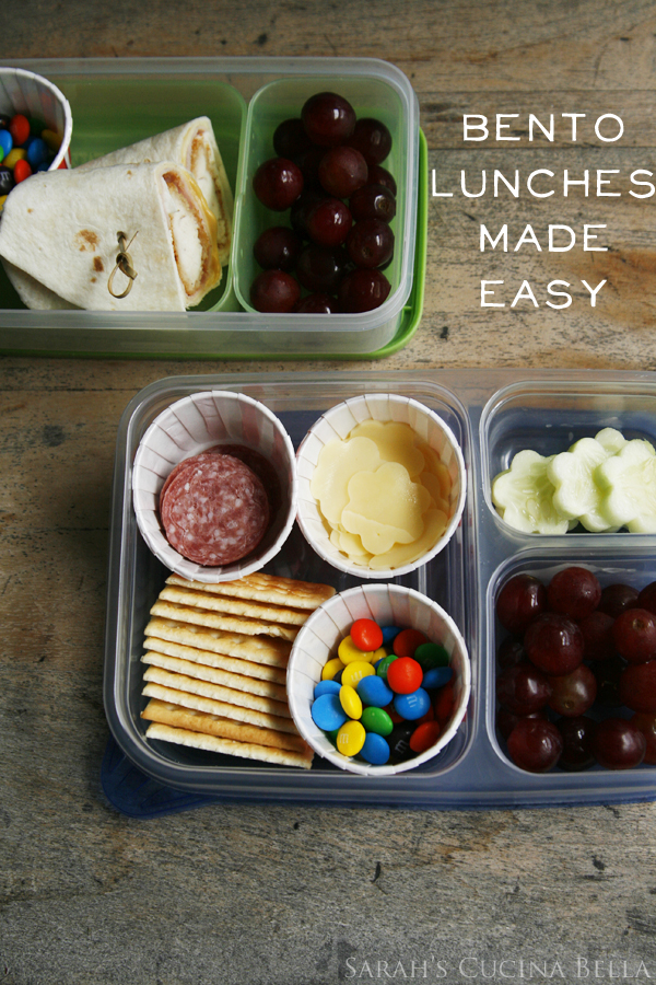 This image shows a compartmentalized container with shaped foods. It illustrates a post on making fun bento-style lunches.